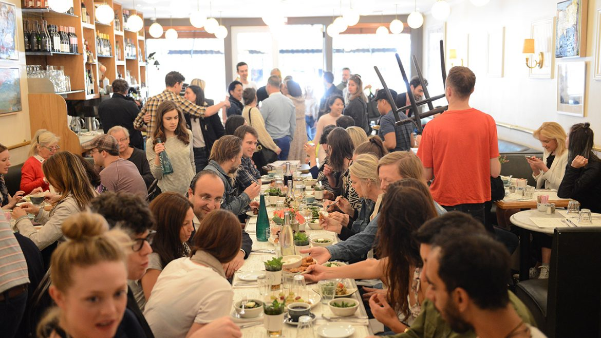 Large group of people eating in a restaurant