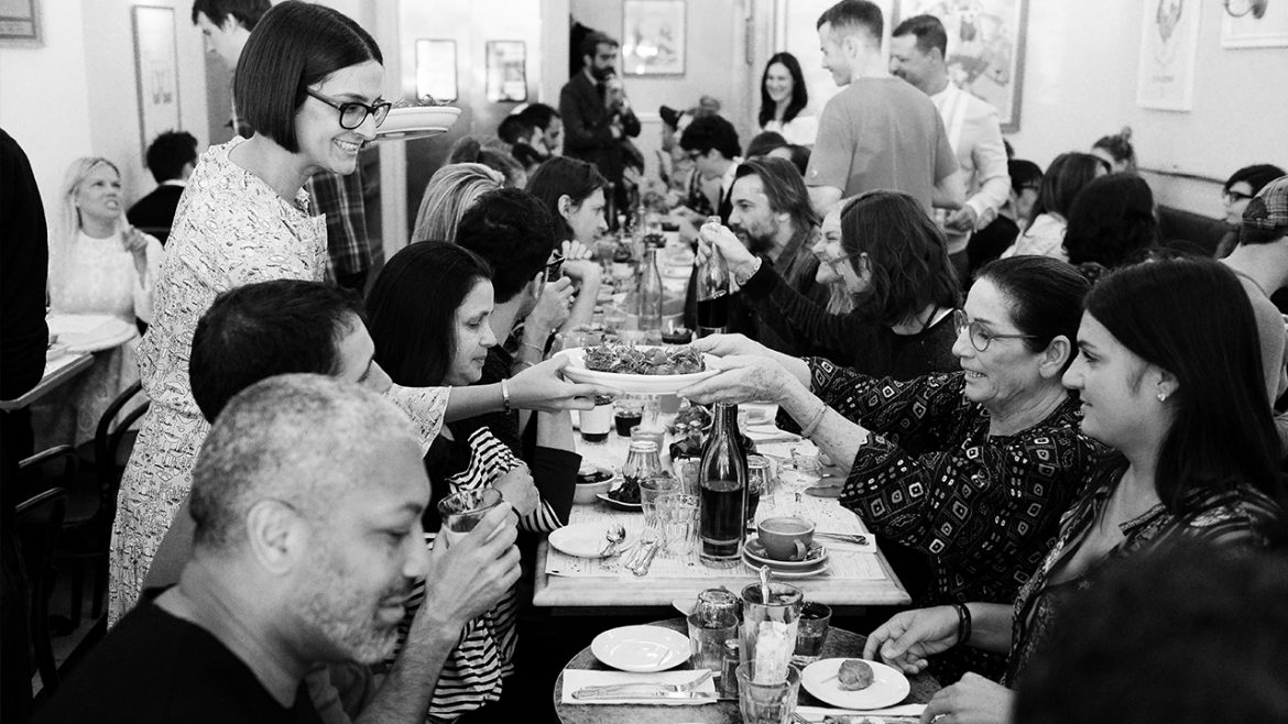 Black and white photo of people eating
