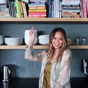 Woman pointing at bookshelf