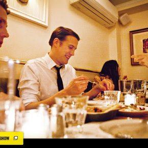 Man at table eating