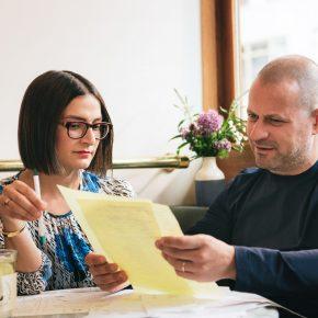 Maya and Dean looking at papers
