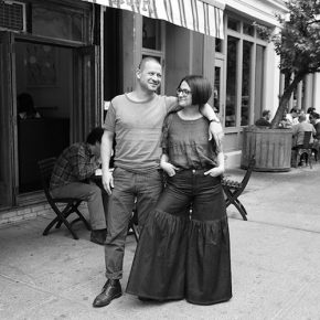 Black and white photo of couple in front of store