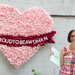 Maya in front of Large Heart Made of Roses